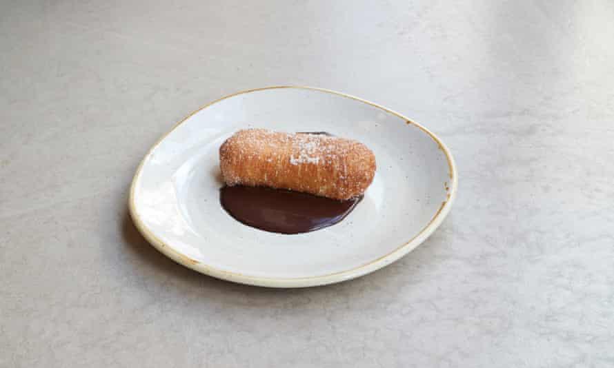 Tast Restaurant's xuixo de crema: a showstopping, plentiful wodge of fresh puff pastry, custard and dark chocolate.