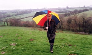 Humphrys walks in a field with an umbrella to protect him from the rain. He is said to love walking, particularly in Wales.