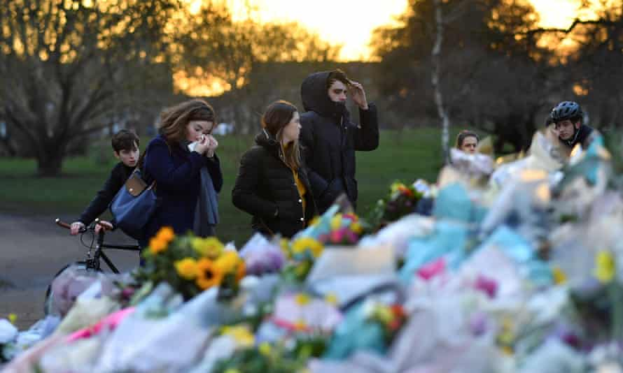 People at the site of the Clapham Common bandstand in London after the death of Sarah Everard.