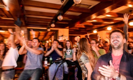 Kosovans celebrate Xhaka's goal as they watch the match in a pub in Pristina.