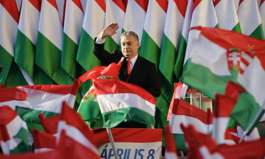 viktor orbán in front of flags