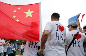 Pro-Beijing supporters attend a rally to support the police and call for an end to violence in Hong Kong on Saturday.