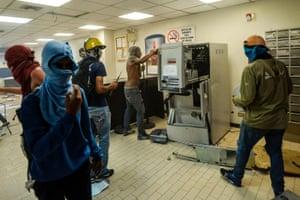 Caracas, Venezuela Anti-government demonstrators damage a branch of Banco Provincial