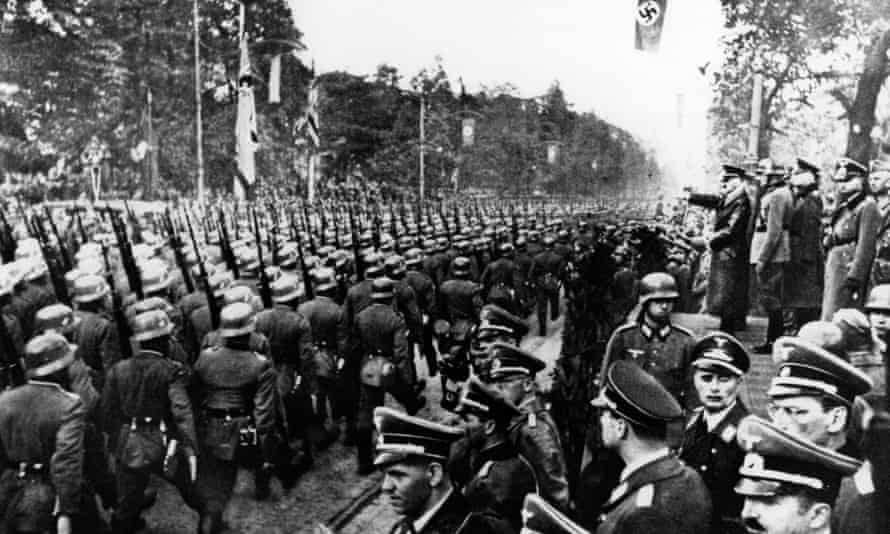 German troops parade in front of Adolf Hitler