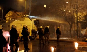 Athens police using a water cannon following a rally for the 45th anniversary of a 1973 student uprising