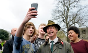 Nigel Farage campaigning in Rochester in 2014, in the kind of country attire that was his signature.