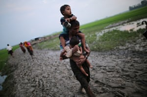 Rohingya Muslims fleeing from ongoing military operations in Myanmars Rakhine state make their way through muddy water after crossing the Bangladesh-Myanmar border to reach a safer place in Cox's Bazar Bangladesh on September 03, 2017