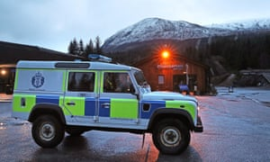 A police vehicle at Nevis Range mountain resort with Aonach Mor in the background.