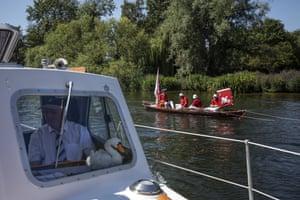 Members of the Vintners team row upstream