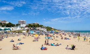 The beach in Bournemouth, Dorset, on a busy and blue sky day; it has been ranked ahead of other UK beaches, including Brighton, Rhossili Bay and Luskentyre by Tripadvisor.
