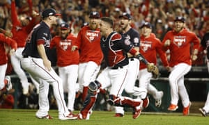 The Nationals pour on to the field after beating the Cardinals