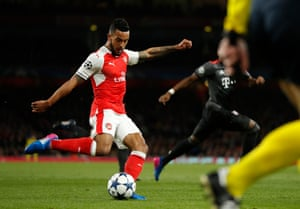 Theo Walcott thumps the ball home to give Arsenal the lead on the night.