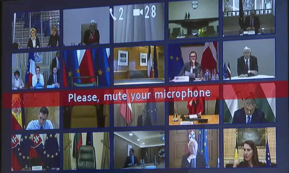 A screen displays video feeds in the first EU virtual summit, on 10 March