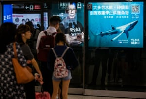 A billboard on a HongKong subway platform features Chinese movie and TV celebrity Bowie Wu-fung calling on restaurants in the city to stop selling shark fin