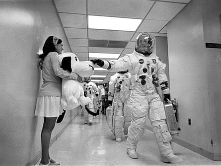 Headed for the launch pad, Apollo 10 Commander Tom Stafford pats the nose of a stuffed Snoopy held by Jamye Flowers (Coplin), astronaut Gordon Cooper's secretary.