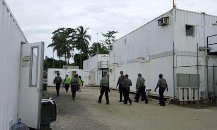 Authorities inside the Manus Island detention centre walking around the camp in February.
