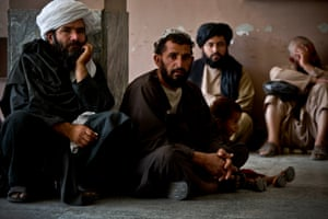Men wait in the hallway of Mirwais hospital to see a doctor in in the outpatients unit