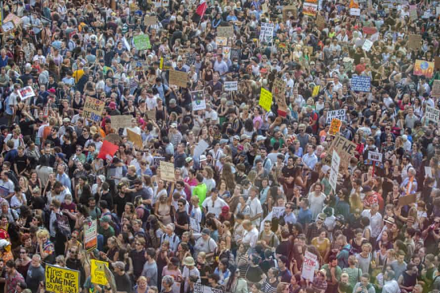 Thousands rally for climate action at Sydney Town Hall on Friday evening as protests were held around Australia in response to the bushfire crisis.