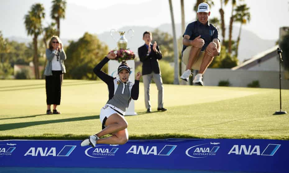 Patty Tavatanakit jumps into Poppie's Pond with her caddie after winning the 2021 ANA Inspiration at Mission Hills.