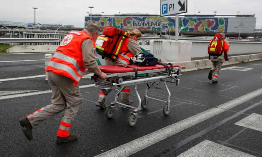 A trolley stretcher is wheeled into Orly airport southern terminal after the shooting.