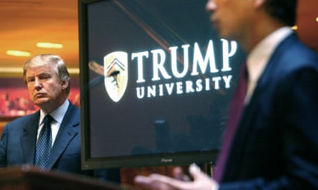 Donald Trump listens as Michael Sexton introduces him at a news conference in New York where he announced the establishment of Trump University on 23 May 2005.