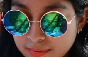 Tegucigalpa, Honduras An image of murdered Honduran environmentalist Berta Caceres is reflected in the sunglasses of a youngster during a International Women's day demonstration