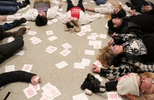 "Protesters stage a ""die-in"" at the Solomon R Guggenheim Museum in Manhattan, New York, against its funding by the Sackler family, the owners of Oxycontin manufacturer Purdue Pharma."