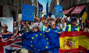 British people and others wave EU and Spanish flags as they protest against Brexit in Malaga in September 2019