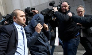 Mazher Mahmood covers his face as he leaves the Old Bailey on 5 October 2016