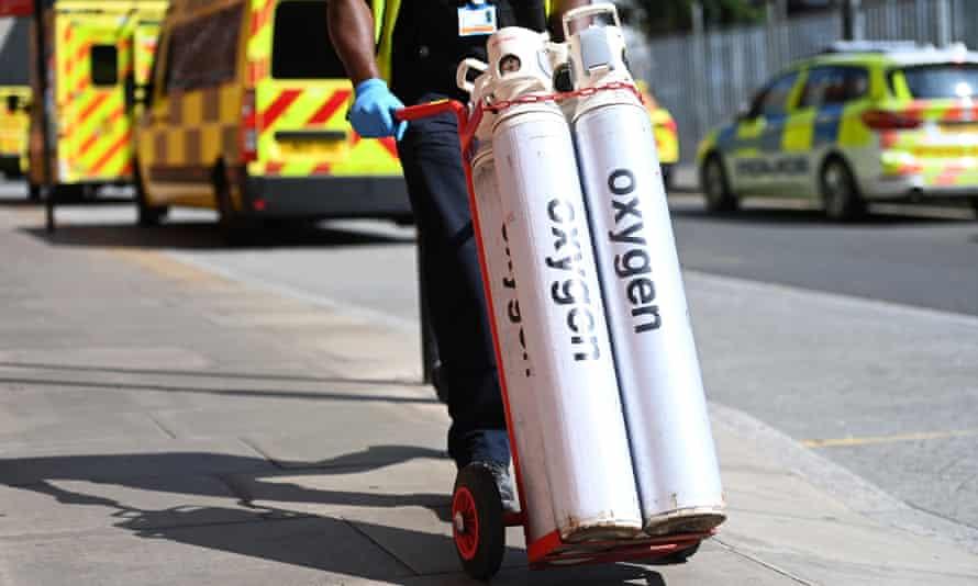 Hospital staff move oxygen tanks outside the Royal London hospital last Friday.