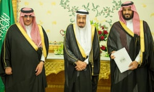 Crown Prince Mohammed bin Nayef, King Salman, and Deputy Crown Prince Mohammed bin Salman stand together after Saudi Arabia's cabinet agreed to implement the Vision 2030 reforms.