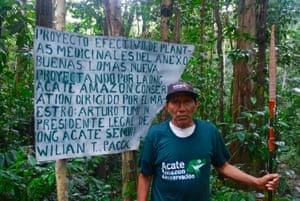 "Traditional healer Arturo Tumi Nëcca Potsad at the entrance to the ""healing forest"" near Buenas Lomas Nueva village in Matsés territory in Peru's Amazon."