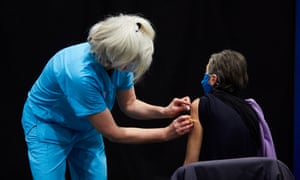 A woman receives a Covid vaccine in Newcastle upon Tyne