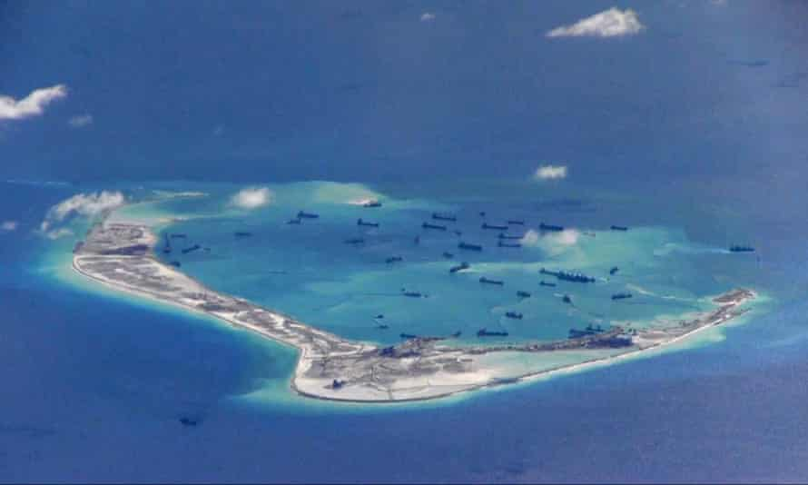 Chinese dredging vessels in the waters around Mischief Reef in the Spratly Islands