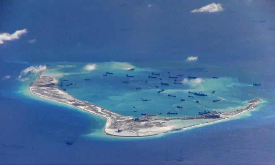 An image from United States Navy video purportedly shows Chinese dredging vessels in the waters around Mischief Reef in the disputed Spratly Islands.