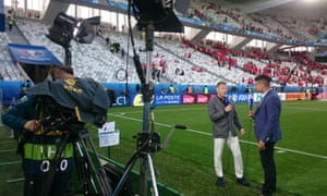 Leon Mann speaks to former Wales striker-turned-pundit Craig Bellamy during his presenting duties for ITV at Euro 2016
