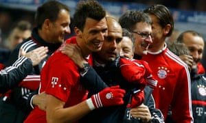 Bayern Munich coach Pep Guardiola celebrates with Mario Mandzukic during their win over Hertha Berlin in 2014.