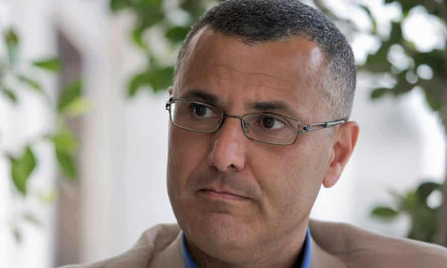 Omar Barghouti listens during an interview with the Associated Press in the West Bank city of Ramallah, Tuesday, May 10, 2016. Barghouti, a Qatari-born Palestinian who is married to an Israeli woman and la eader of the international boycott movement against Israel, on Tuesday accused Israeli authorities of imposing a travel ban on him as retribution for his political activities.