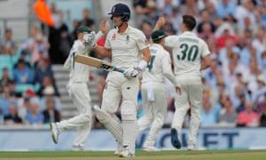 England's Joe Denly trudges off as Australia's Pat Cummins celebrates taking his wicket.