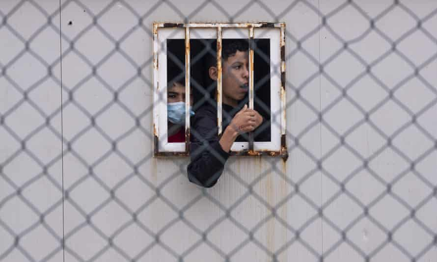 Children who crossed into Spain wait inside a temporary shelter for unaccompanied minors in Ceuta.