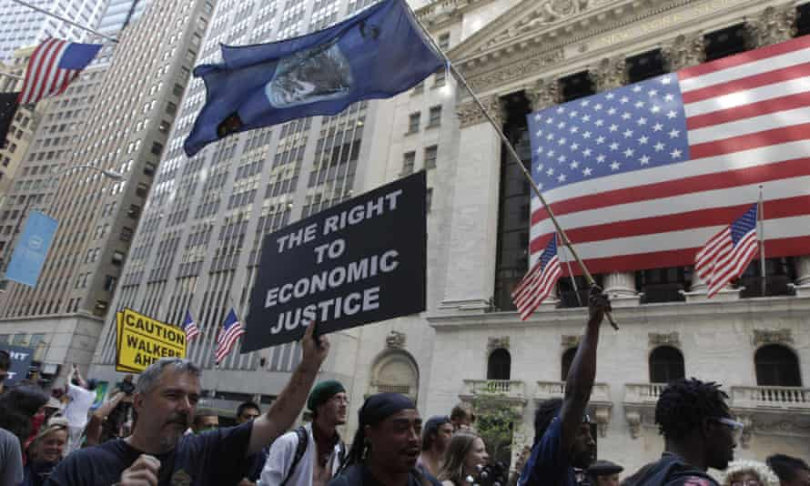 Occupy Wall Street protesters march past the New York Stock Exchange.