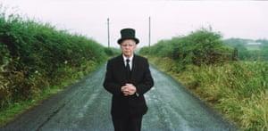 Johnny McKeegan, an undertaker, stands near the border between County Fermanagh and County Cavan in Enniskillen, Northern Ireland