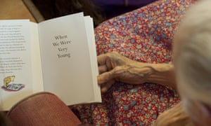 A volunteer from the Kissing it Better charity reads poems to a resident of a retirement home in Stratford upon Avon who has dementia