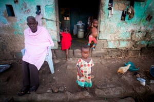 A family outside their home in the fishing village of Nyanyano