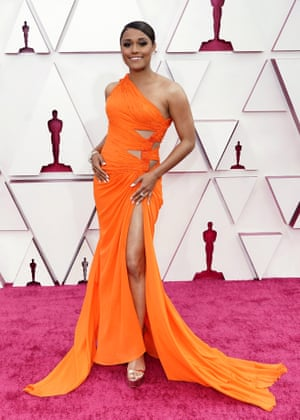 In a cut out, tie-side neon statue gown slit higher than we're used to, Ariana DeBose casts another vote for red carpet neons.