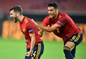 Jose Luis Gaya (left) celebrates with teammate Mikel Merino after Spain's equaliser.