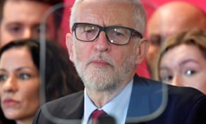 Britain's opposition Labour Party leader Jeremy Corbyn is seen through an autocue during a speech.