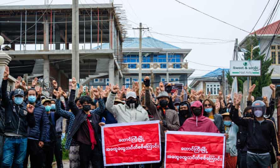 Protesters in Taunggyi hold up Easter eggs and make the three-finger salute during a demonstration against the military coup.