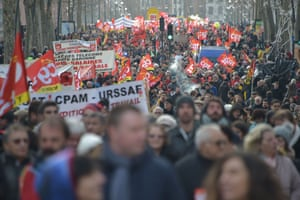 Toulouse, FranceProtesters march during a demonstration as part of a nationwide multi-sector strike against the French government's pensions overhaul.
