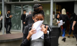 A student reacts as she receives her A-level results at City and Islington College in 2017.